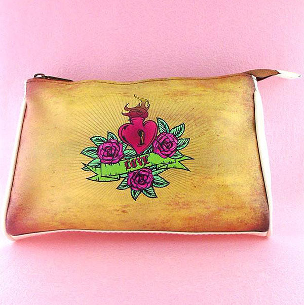 Shop online for Mlavi's Eco-friendly faux/vegan leather makeup pouch with whimsical playful tattoo style sacred heart & rose flower print. Great gift idea for tattoo lovers. Wholesale available at http://www.mlavi.com for gift shops and boutiques