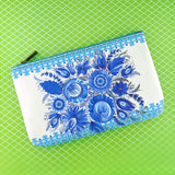 Shop Mlavi Studio's vegan leather medium flat/makeup pouch for women with Ukrainian Petrykivka style flower print print. Great for everyday use & a unique gift for yourself & family & friends. More Ukraine themed bags, wallets & other fashion accessories are available for wholesale at www.mlavi.com for gift shop & boutique buyers worldwide.