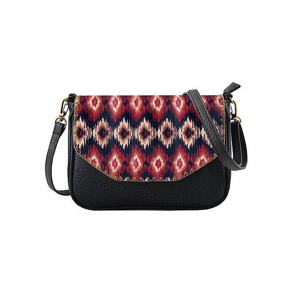Shop Mlavi bohemian style Ikat print vegan leather cross body bag made with Eco-friendly & cruelty free vegan materials. This ethically made purse for women can also use as a clutch-great for everyday, wonderful as a gift to your loved ones. Wholesale available at www.mlavi.com to gift shop & boutique buyers worldwide.