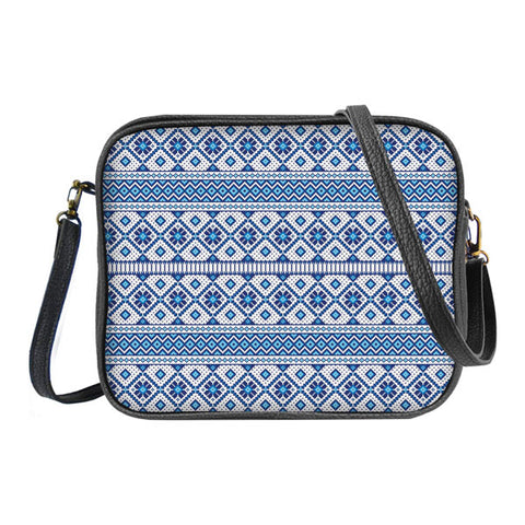 Shop Mlavi's whimsical Nordic Scandinavian pattern print vegan leather crossbody bag made with SGS tested toxic-free Eco-friendly cruelty free vegan materials. Wholesale available at www.mlavi.com for gift shop, fashion accessories & clothing boutique in Canada, USA & worldwide.