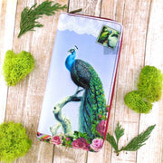 Shop Mlavi vegan leather vintage style large vegan zipper wallet features whimsical peacock illustration. A great gift idea. More whimsical fashion accessories are available for wholesale at www.mlavi.com for gift shop,  , fashion accessories & clothing boutique buyers in Canada, USA & worldwide.