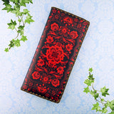 Shop Mlavi Studio's vegan leather large flat wallet for women with Ukrainian poppy flower embroidery pattern print print. Great for everyday use & a unique gift for yourself & family & friends. More Ukraine themed bags, wallets & other fashion accessories are available for wholesale at www.mlavi.com for gift shop & boutique buyers worldwide.