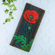 Shop Mlavi's vegan leather large flat wallet for women with Ukrainian poppy flower & embroidery pattern print. Great for everyday use & a unique gift for yourself & family & friends. More Ukraine themed bags, wallets & other fashion accessories are available for wholesale at www.mlavi.com for gift shop & boutique buyers worldwide.