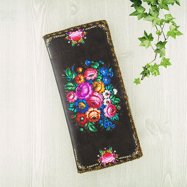 Shop Mlavi's vegan leather large flat wallet for women with Ukrainian flower print print. Great for everyday use & a unique gift for yourself & family & friends. More Ukraine themed bags, wallets & other fashion accessories are available for wholesale at www.mlavi.com for gift shop & boutique buyers worldwide.