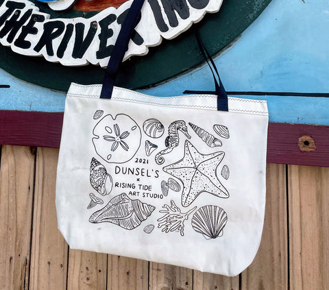 New Dunsel's Tote with seashell artwork on the face of the bag.