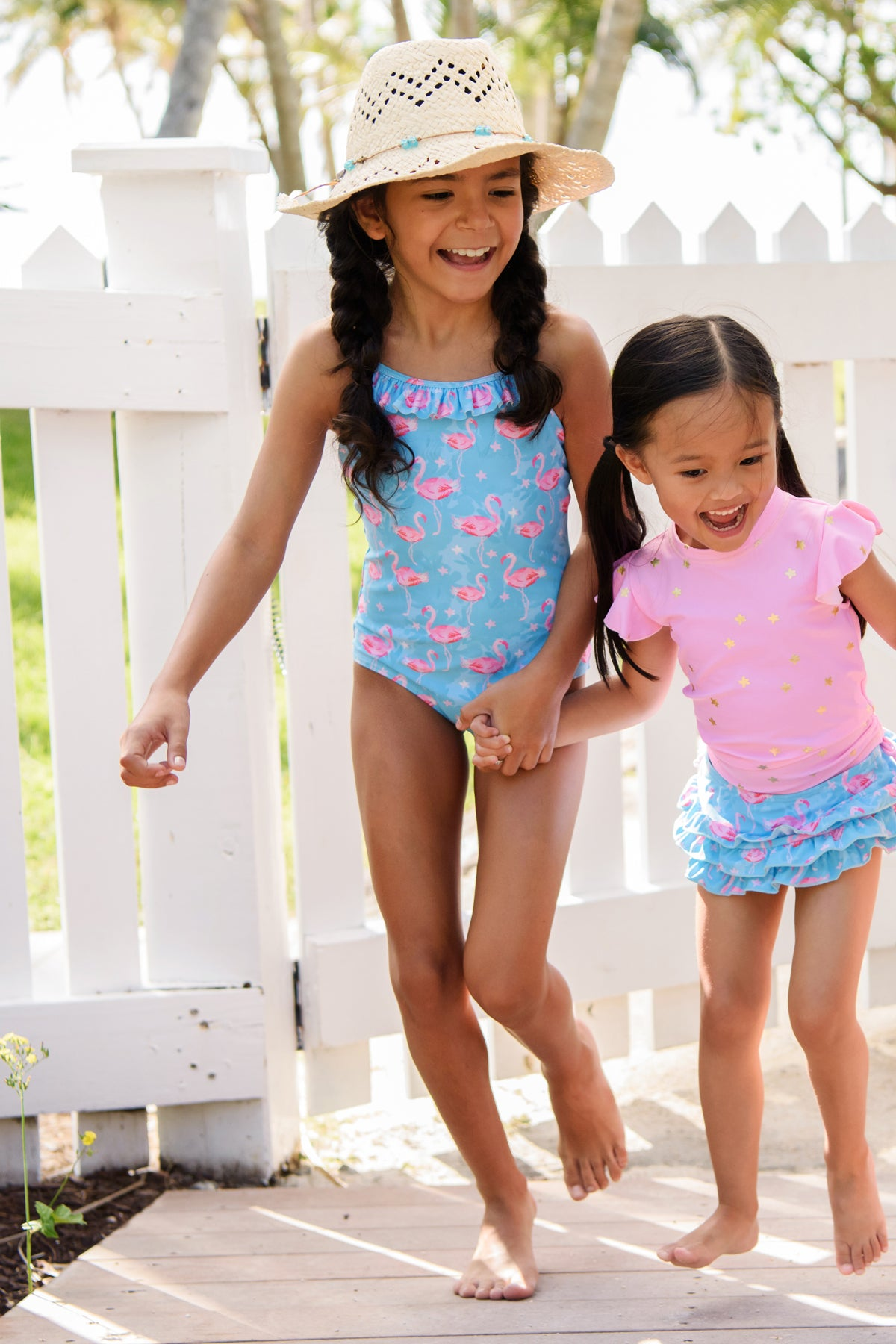 72f54577640cf ... girls swimsuits, rashguards and cover-ups in a variety of vibrant  colors and prints. Snapper Rock Blue Flamingo Swimsuit
