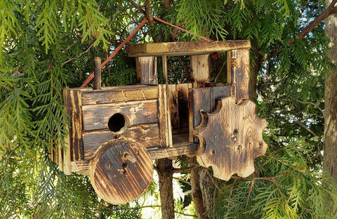 Handcrafted wood tractor birdhouse burned with a torch