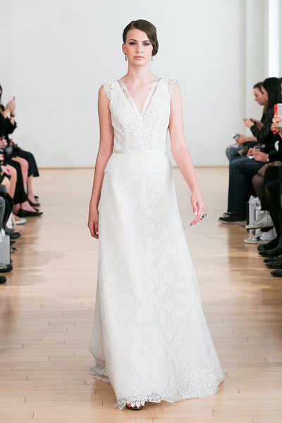 Junko Yoshioka Bridal Gown - lace, sleeveless, A-line gown with blush chiffon underlay. Ribboned re-embroidered lace trim accentuates natural waistline and v-neck