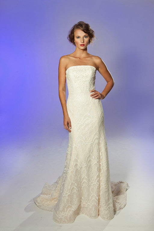 Junko Yoshioka Bridal Gown - Lace and sequin modified A-line gown with embroidery detail throughout. Strapless, crescent moon bodice