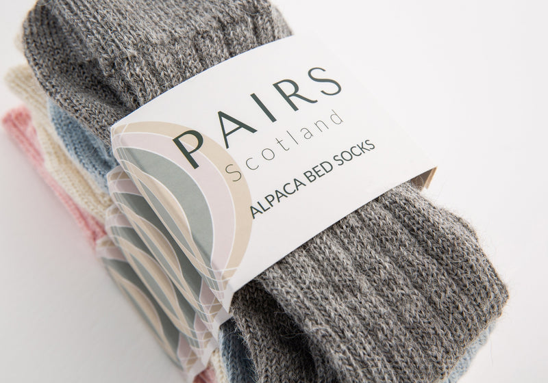 alpaca wool bed soft men and women sock range in soft hues, four pairs piled up