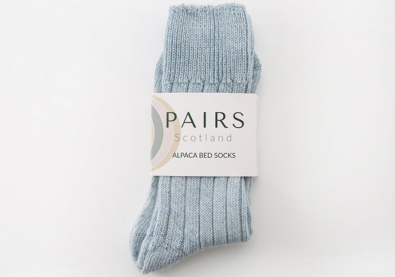 alpaca light blue bed socks in brand packaging
