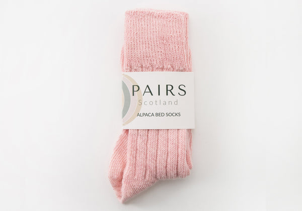alpaca pink soft wool bed socks in brand packaging
