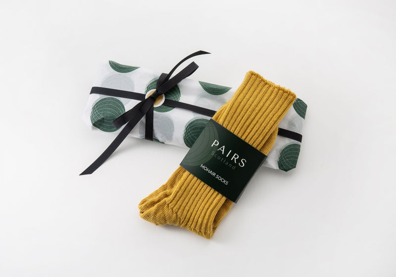 mohair alpaca wool socks gift wrap with yellow mustard pair of socks