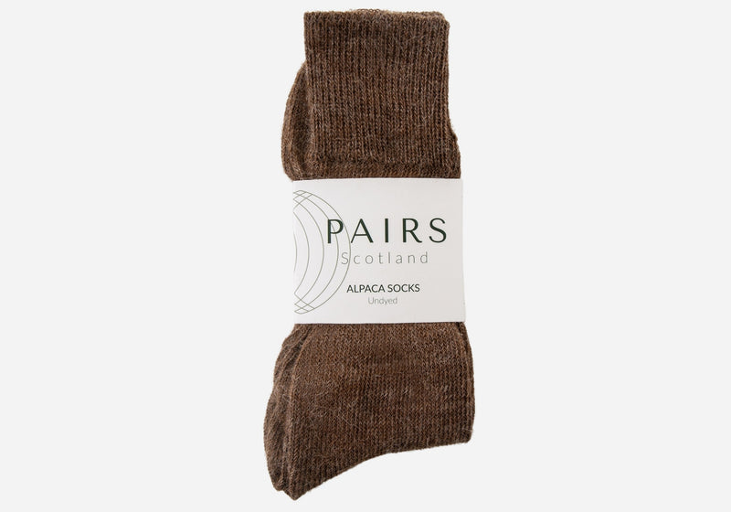 natural undyed brown alpaca wool socks in brand packaging
