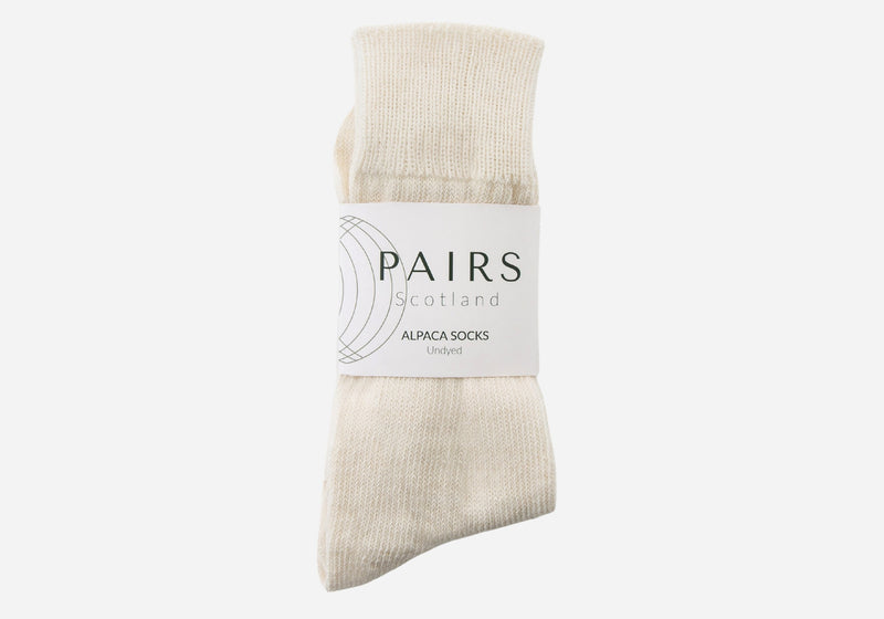 natural undyed cream white alpaca wool socks in brand packaging