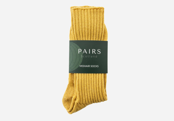 yellow mustard mohair socks in brand packaging