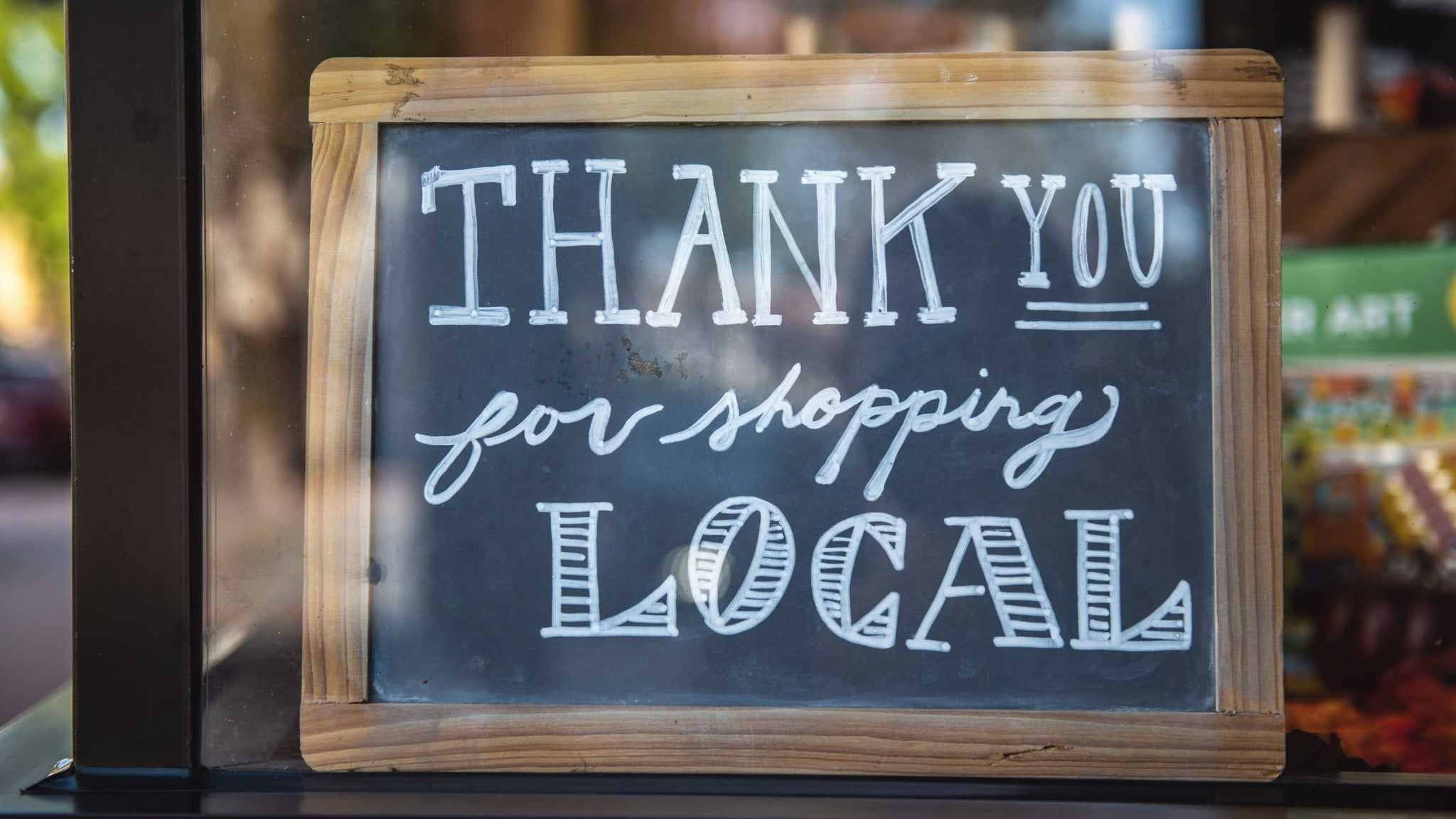 Thank you for shopping local sign in the window