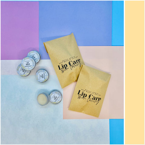 Lip balms with branded envelopes on colourful background
