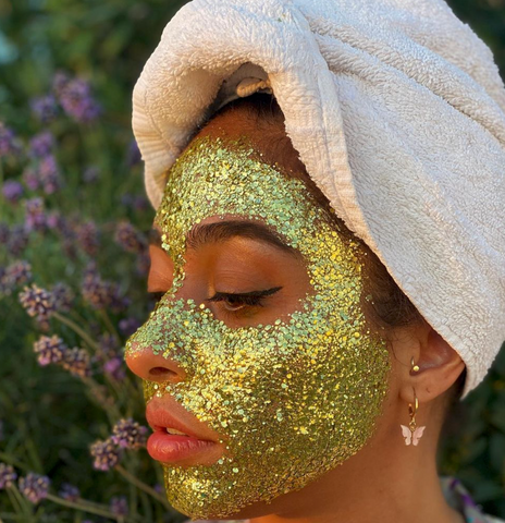 Girl with gold glitter on her face