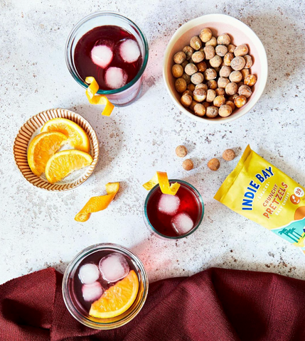 bowls of snacks with drinks on a table