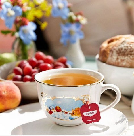 a pretty tea cup with yogi tea label and flowers