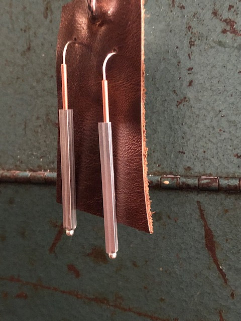 Mixed metal tube on tube with square on round and sterling on copper