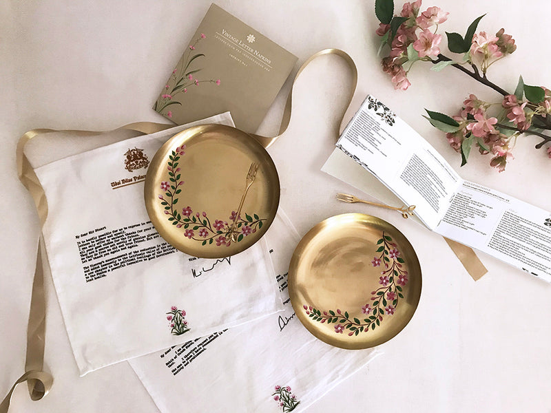 handpainted brass plates with leaf fork _ set of 2 vintage letters printed cotton napkins _ story telling gifts _ mughal recipe handbook _ royal luxury gifting