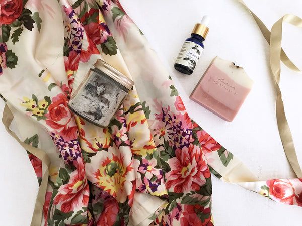 best gifts for brides on their wedding , a beautiful floral print satin robe with rose bath salt , a hamdmade cold pressed soap and essential oil