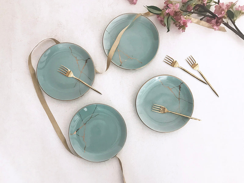 Set of 4 Sea blue ceramic quarter plates with handmade brass fork.