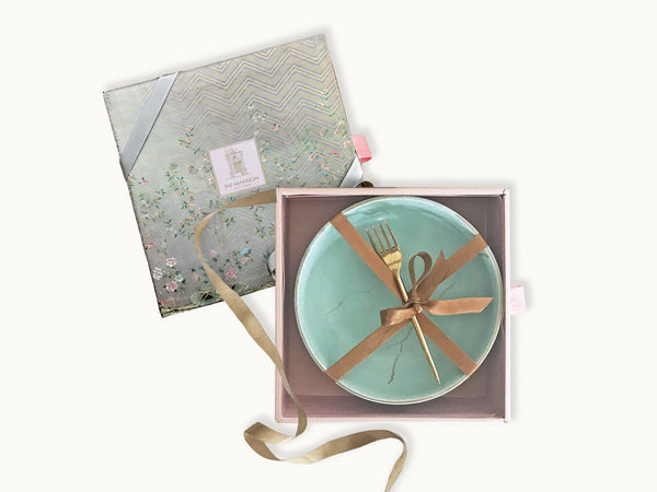A beautiful Kintsugi charm gift box which contains a set of 2 handmade ceramic pasta bowls along with 2 handmade brass fork.