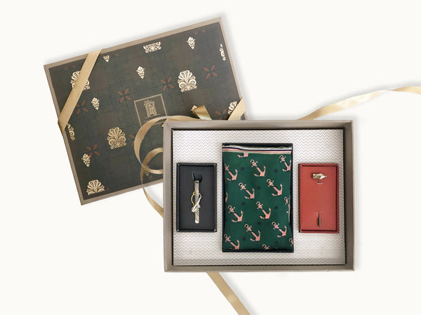 Sauve gift box for men with silk anchor pocket square in green, a quirky ink pen lapel pin and a tie pin with trumpet
