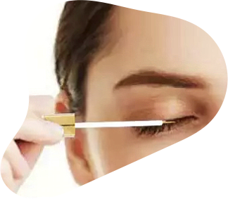 woman putting eyebrow enhancing growth serum