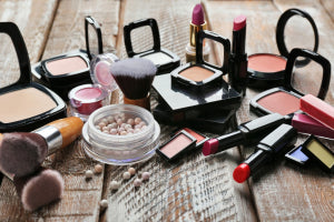 cosmetics on wooden table