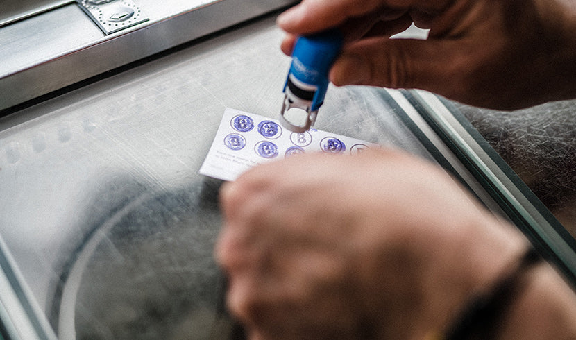 loyalty card being stamped at a kiosk