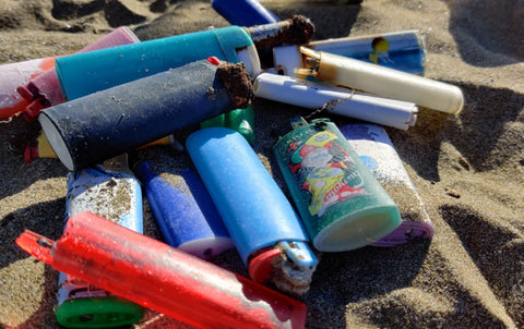 Lighters found at Feniglia's beach. Orbetello, Italy
