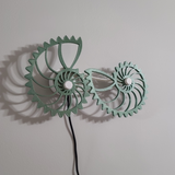 Nautilus gear kinetic living wall art