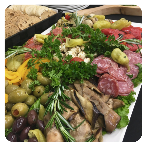 Italian antipasto platter topped with fresh parsley