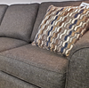 Grey Sofa Bed and Throw Pillow