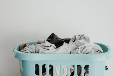 doing laundry at home with clothes in a basket