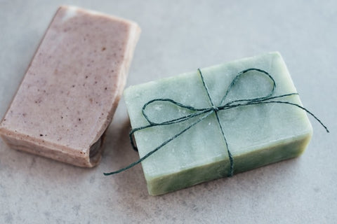 natural handmade soaps with different colors and a ribbon