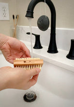 Load image into Gallery viewer, Wood nail brush cleaning nails in the sink