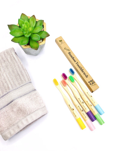 bamboo toothbrushes for kids in multiple colors