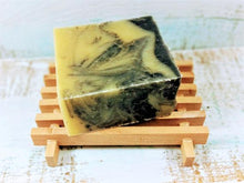 Load image into Gallery viewer, Light colored wooden soap dish with natural soap on top