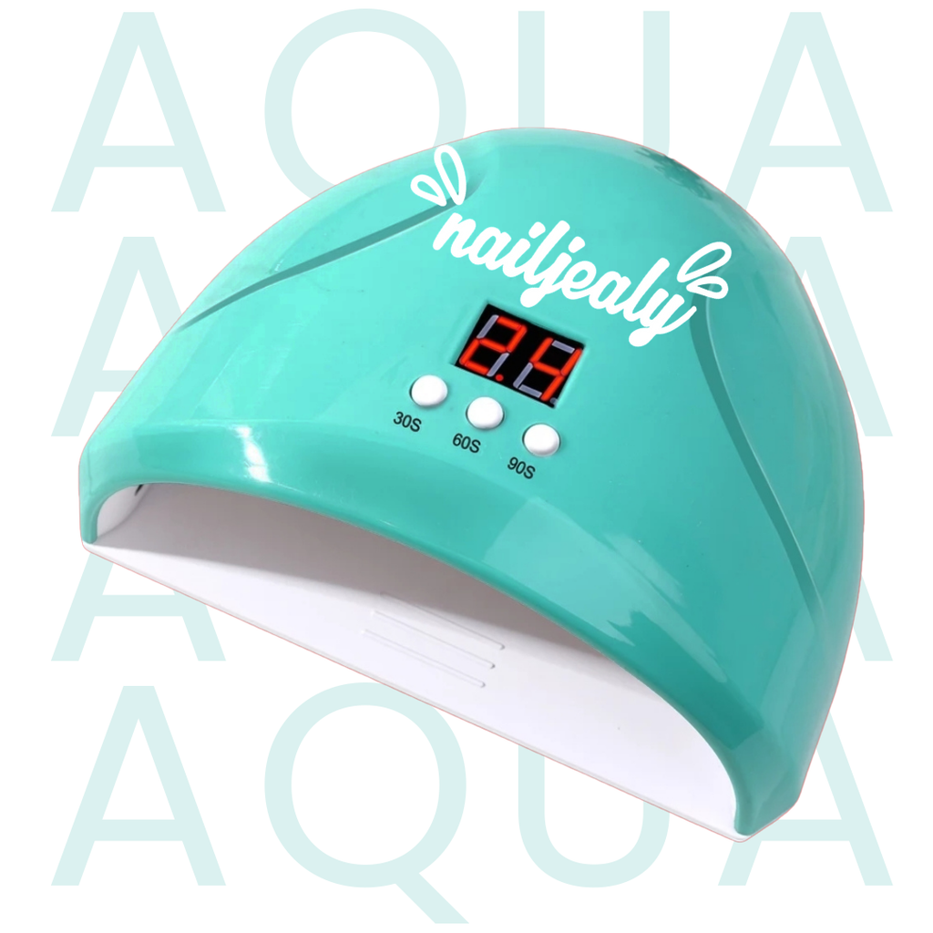 Image of an aqua coloured LED nail lamp with a white NailJealy logo. The background is white with the word 'AQUA' repeating in capitals.
