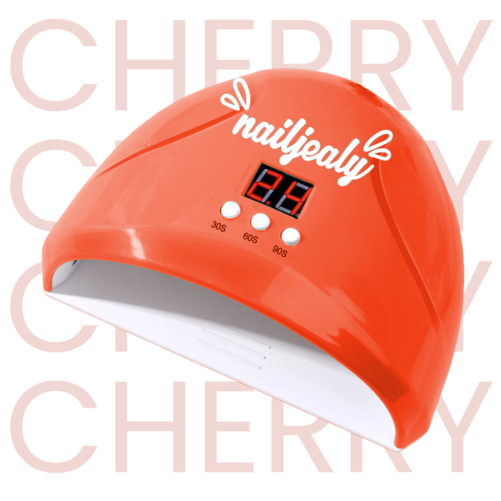 Image of a cherry coloured LED nail lamp with a white NailJealy logo. The background is white with the word 'CHERRY' repeating in capitals.