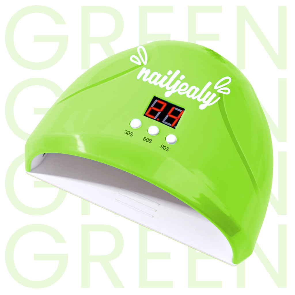 Image of a green coloured LED nail lamp with a white NailJealy logo. The background is white with the word 'GREEN' repeating in capitals.