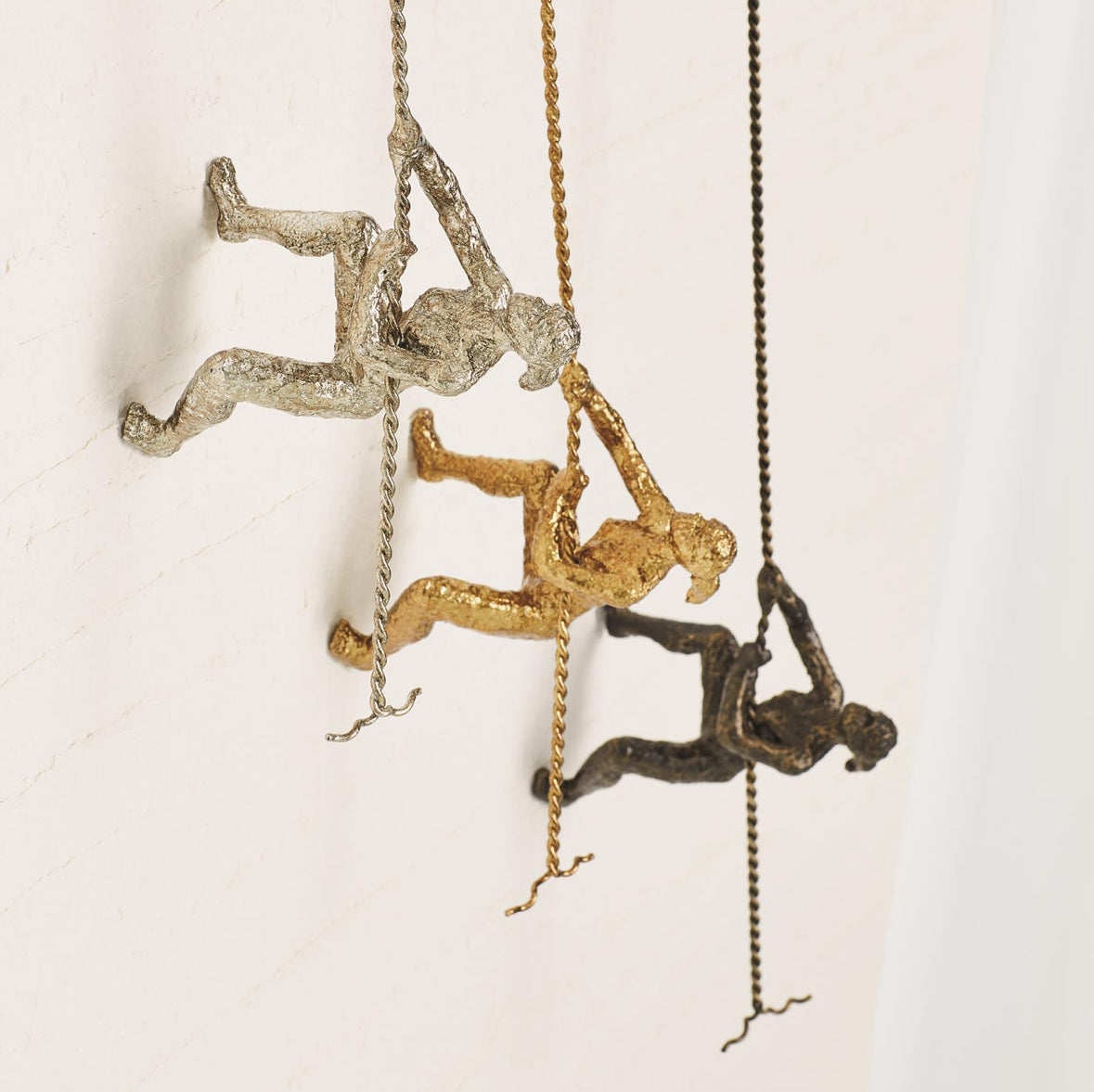 Climbing Woman-Gold, Silver & Bronze