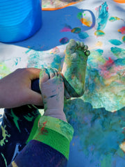 Baby feet covered in paint