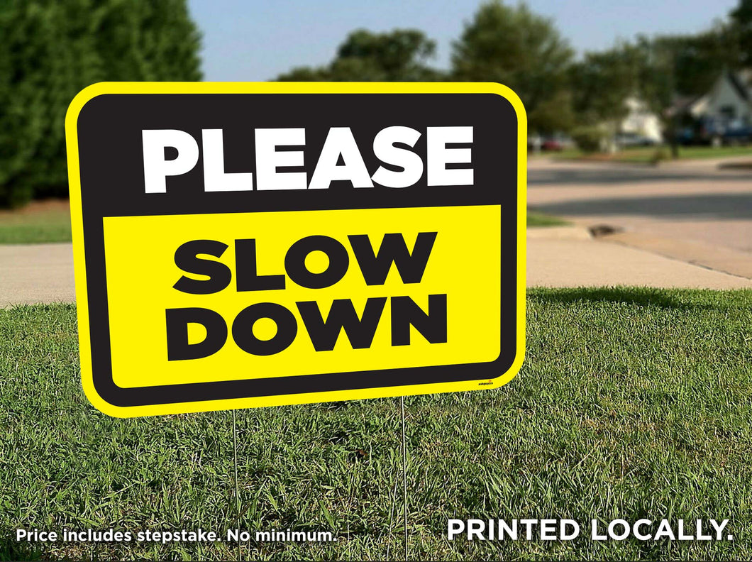 Slow Down lawn signs