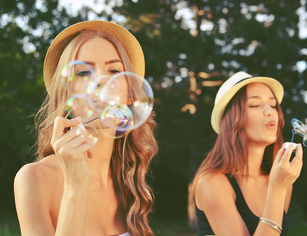 Summer outdoor entertaining blowing bubbles